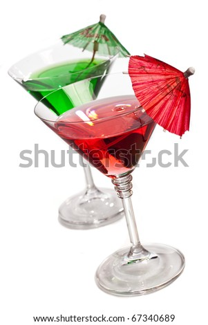 Cocktails with umbrellas served in classic martini glasses