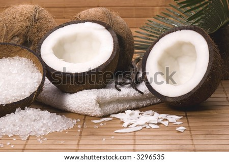coco bath. coconuts, vanilla, salt, towels, bamboo, palm leaf. exotic scene