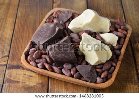 Cocoa beans, cocoa butter and cocoa mass on brown background #1468281005