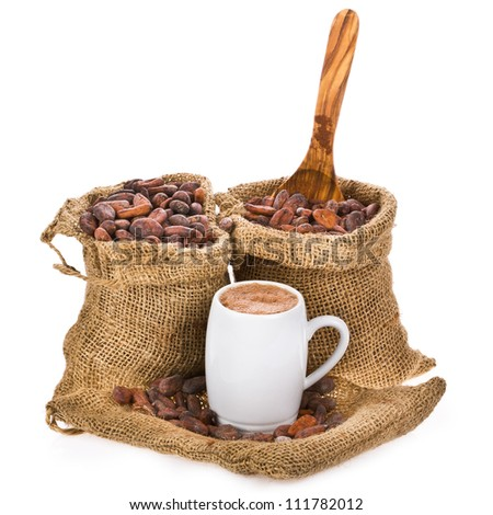 cocoa beans in bags of canvas, a mug of cocoa drink, isolated on white background