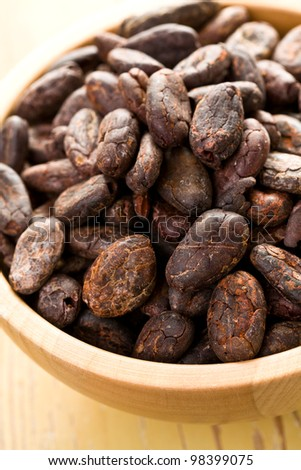 cocoa beans in bowl on the kitchen table