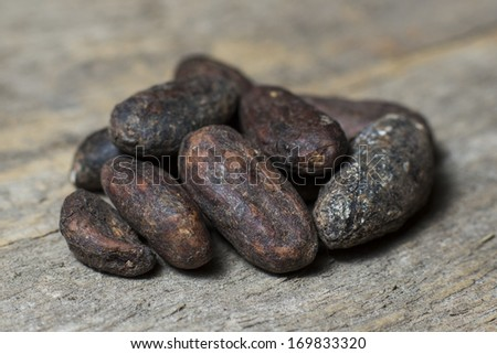 cocoa beans on a wooden background