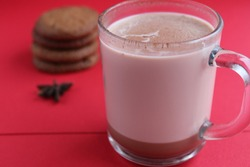 Cocoa hot chocolate in a glass mug on a red background with room for text copyspace and liver on hellish plan