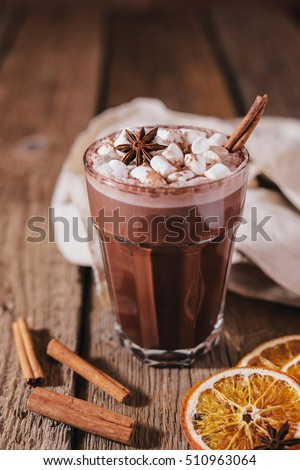 Cocoa or latte or hot chocolate with marshmallow and flavored with cinnamon. On a brown wooden background. Christmas present. Christmas concept. Christmas holiday. #510963064