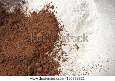 Cocoa powder and milk powder in a bowl