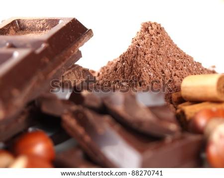 cocoa powder mountain, chocolate bars, nuts, vanilla
