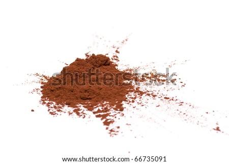 Cocoa powder on a white background - stock photo