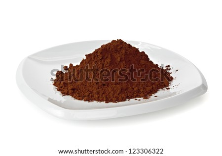 Cocoa powder pile in plate on white background