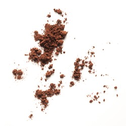 cocoa powder scattered on white