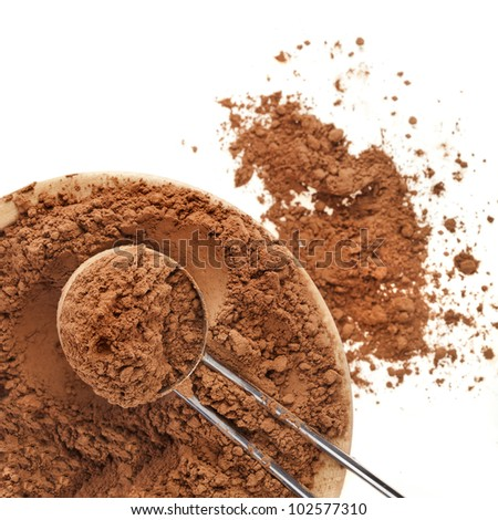 cocoa powder with scoop isolated on white background