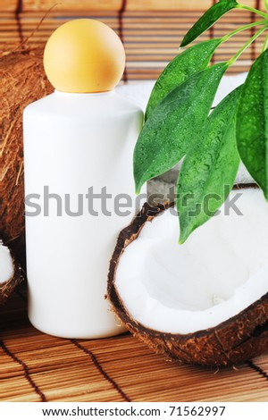 Coconut and massage oil for  body on straw napkin