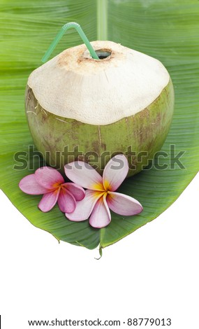 coconut beverage straw cocktail on tender banana leaf isolated
