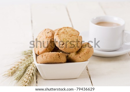 Coconut butter cookies with cup of tea