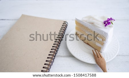Coconut Cake and  with a brown book set together on the desk. Concept copy space and working with break breaks