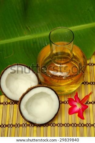 Coconut, coconut oil and plumeria - stock photo