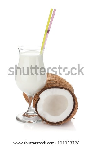 Coconut cream cocktail and coconuts. Isolated on white background