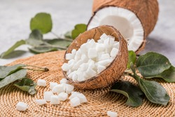 coconut cubed in bowl on wooden table background.