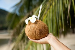 Coconut drink in hand