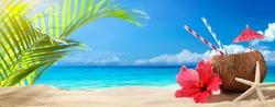 Coconut drink on sand beach,summer vacation on beach.