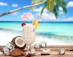 Coconut drink on the beach
