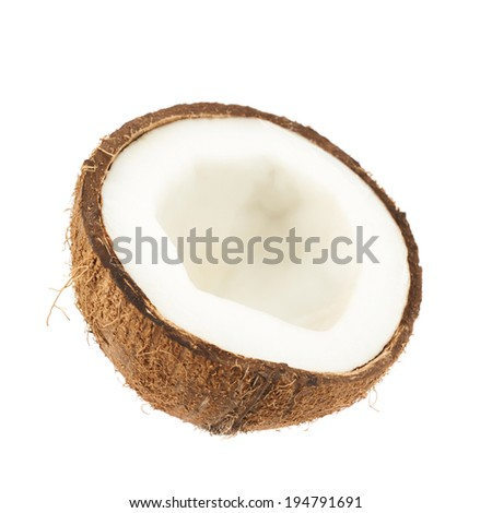 Coconut fruit cut in half isolated over the white background