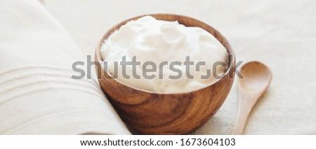 coconut greek yogurt in wooden bowl, dairy free, gluten free, probiotic food for gut health ストックフォト ©
