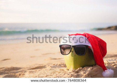 Coconut Holiday with glasses and Santa Claus hat, concept Christmas on the beach Tropical design made in Phuket, Thailand. #764808364