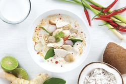 Coconut milk soup with chicken and Thai ingredients on the table, top view, Thai food that is popular in Thailand.