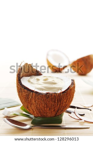 Coconut mousse dessert served in a coconut