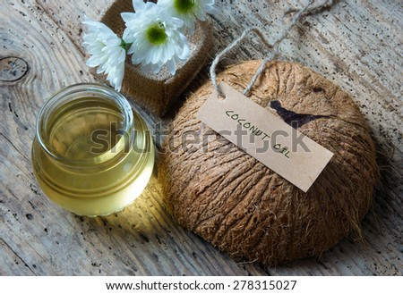 Coconut oil, essential oil from nature, a skin care that safe, rich vitamin, use in massage at spa, organic cosmetic on wooden background