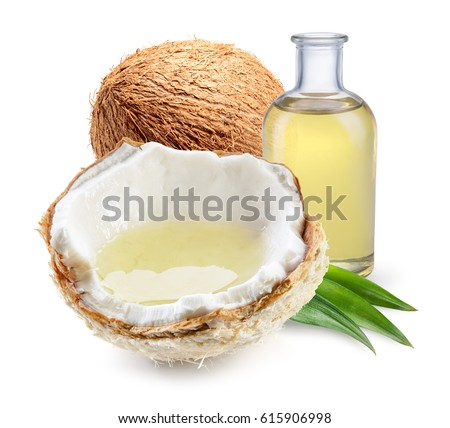 Coconut oil with fresh nut isolated on white background. Full depth of field.