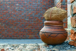 coconut on clay urn religious tradition of hindus on building new home