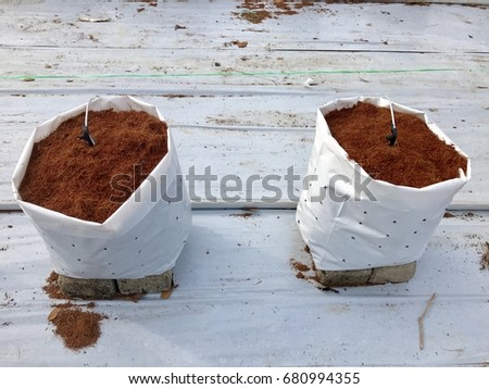 Coconut soil in bag for fertigation farm , Fertigation is related to chemigation, the injection of chemicals into an irrigation system. #680994355
