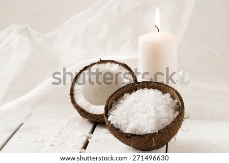 Coconut Spa and wellness setting (coconut, sea salt, scented candle with coconut, coconut oil) on a white background