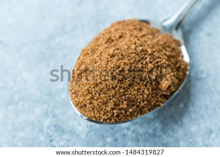 Coconut Sugar in Plastic Metal Spoon Ready to Use.