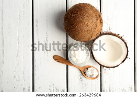 Shutterstock Coconut with coconut oil in jar on wooden background