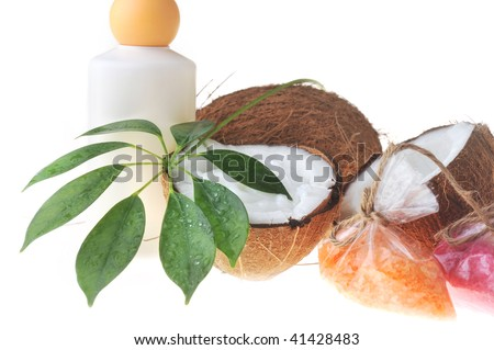 coconut with cream , towel  and salt for bath on white background