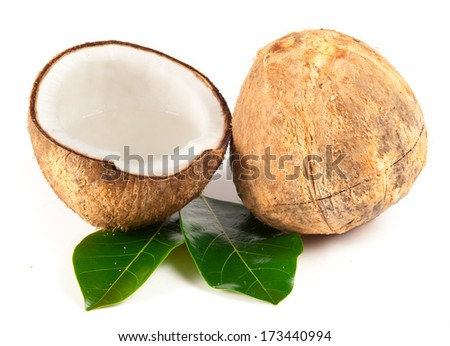 Coconut with green leaves isolated on white