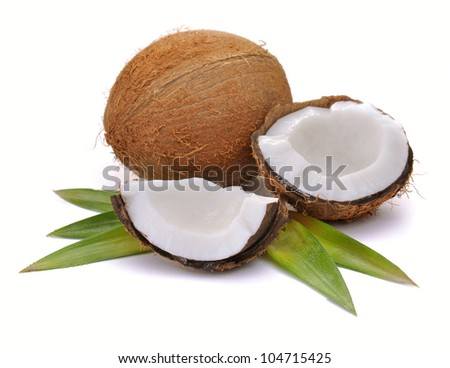 Coconut with leaves closeup on a white background