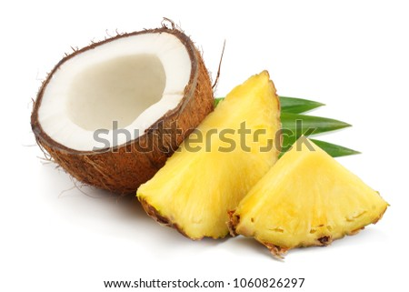 Coconut with pineapple and green leaves isolated on white background stock photo