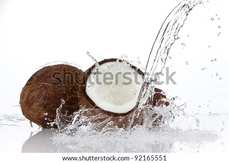 Coconuts in water splash, isolated on white background