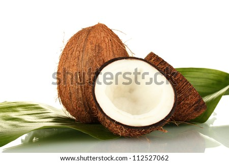 coconuts with green leaf on white background close-up - stock photo