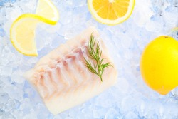 Cod fish fillets on ice with fresh Lemon