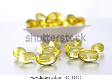 Cod liver oil capsules in a white bowl