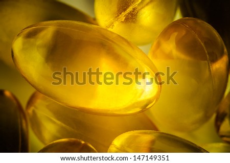 Cod liver oil capsules macro - stock photo