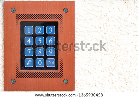 Code keypad on apartment building close-up with copy space #1365930458