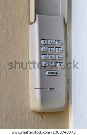 Code Keypad used on a garage door entrance to a home - security keypad - security code #1308748078