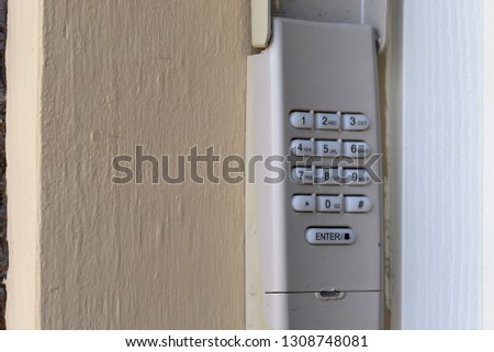 Code Keypad used on a garage door entrance to a home - security keypad - security code #1308748081