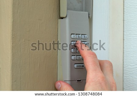 Code Keypad used on a garage door entrance to a home - security keypad - security code #1308748084