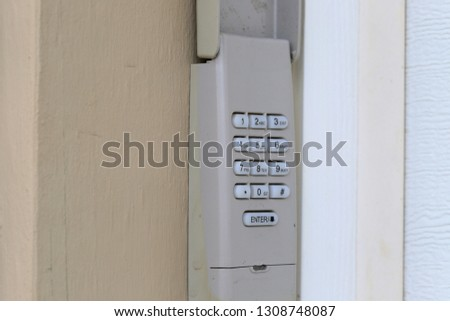 Code Keypad used on a garage door entrance to a home - security keypad - security code #1308748087
